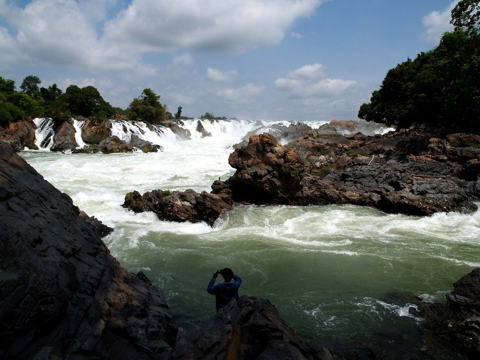 rapid waterfall among the jungle of Laos