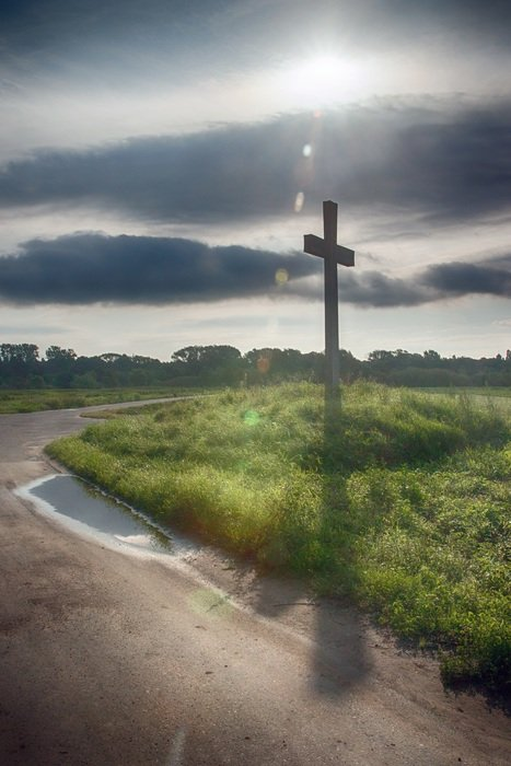 Christian cross on the edge of a country road in Saarland, Germany