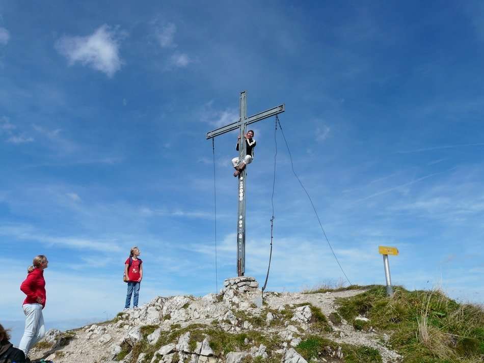 Tourists near the cross at the top of the Alps