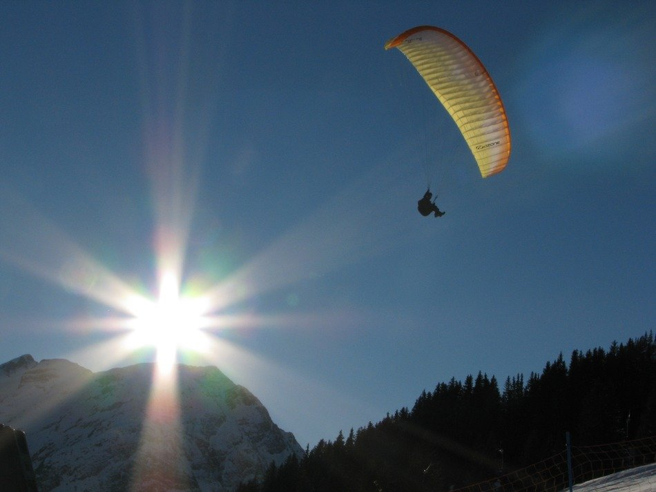 Paraglider in the mountains of the Arlberg