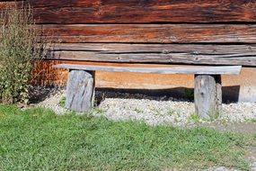 bench near the wooden house