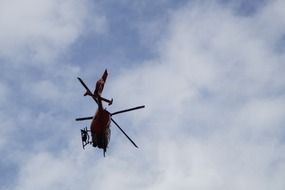 mountain rescue helicopter in the blue sky