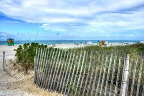 amazing south beach sand fence sky clouds