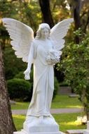 white angel sculpture in a cemetery