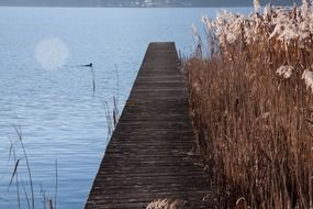 Wooden boardwalk on a lake