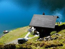 mountain hut on the banks of Alpine lake in Switzerland
