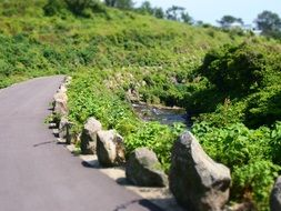 winding road on the jeju island in Korea
