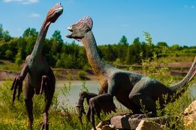 models of dinosaurs in the park