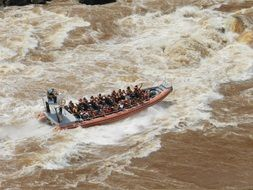 rafting boat in a stormy river