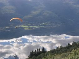 skydiver soars above the clouds in Norway
