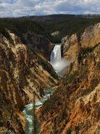 scenic lower falls and stream in valley of gorge canyon, usa, wyoming, yellowstone national park