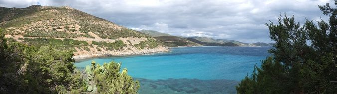 turquoise water near a hill in sardinia