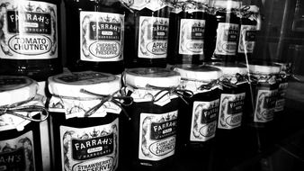black-and-white image of jars with jam