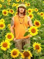 hippie, young caucasian man in sunflowers