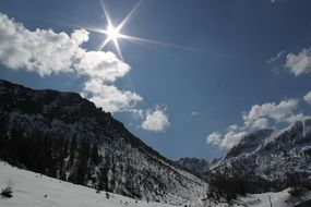 sunny alpine mountain winter landscape