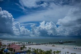 clearwater beach with fluffy clouds
