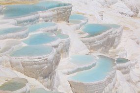 ancient geological limestone with blue water