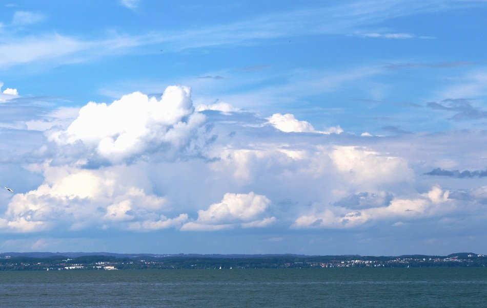 white cumulus clouds over the ocean