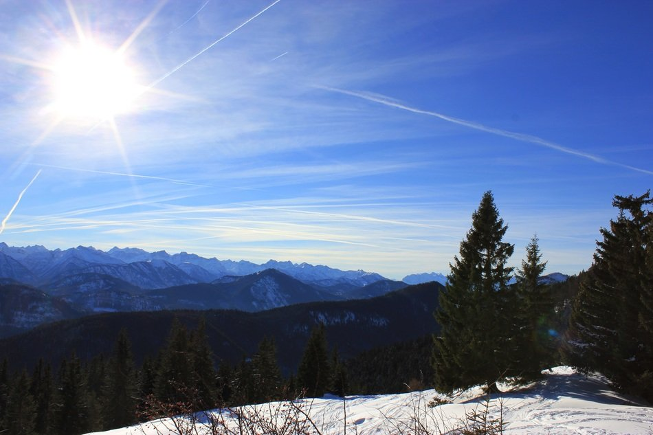 bright sun over snow-capped mountains