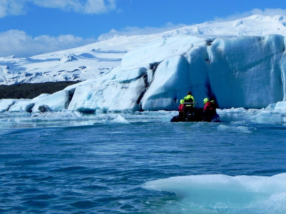 tourists on an inflatable boat in the glacial lagoon in Iceland