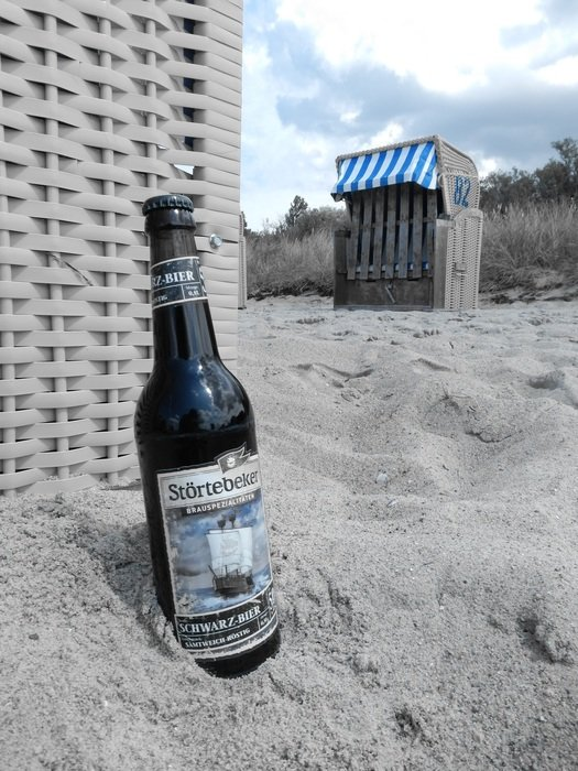 dark beer on the beach of the Baltic Sea