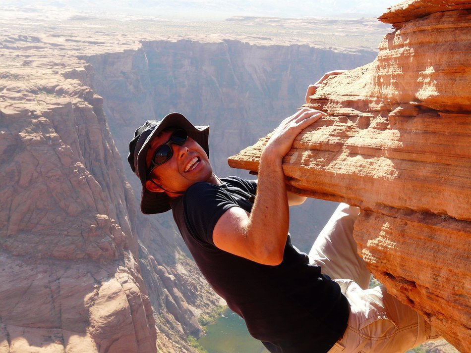 climber on a cliff in Horseshoe Bend