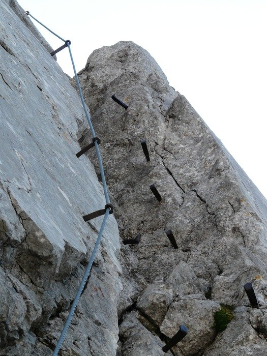 iron pins on the cliff for climbing