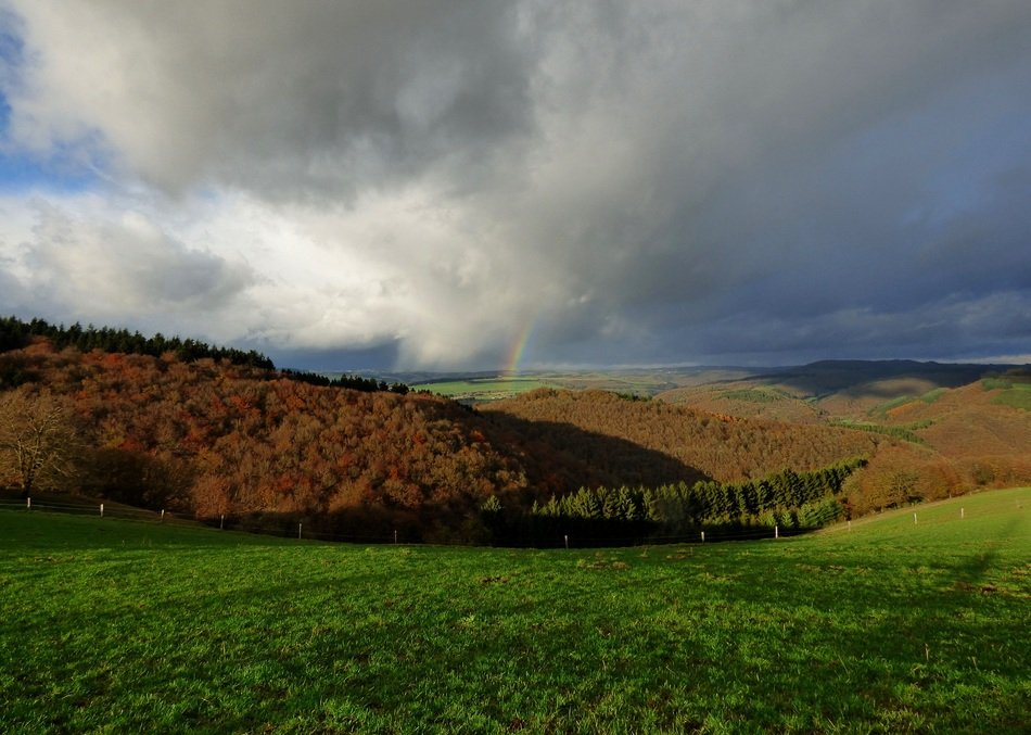 rainbow and stormy sky over hills in Luxembourg
