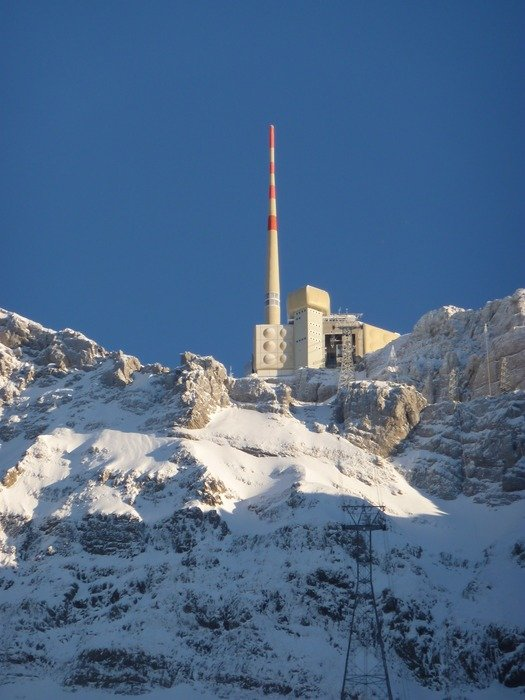 landscape of building on a snowy alps mountains in switzerland