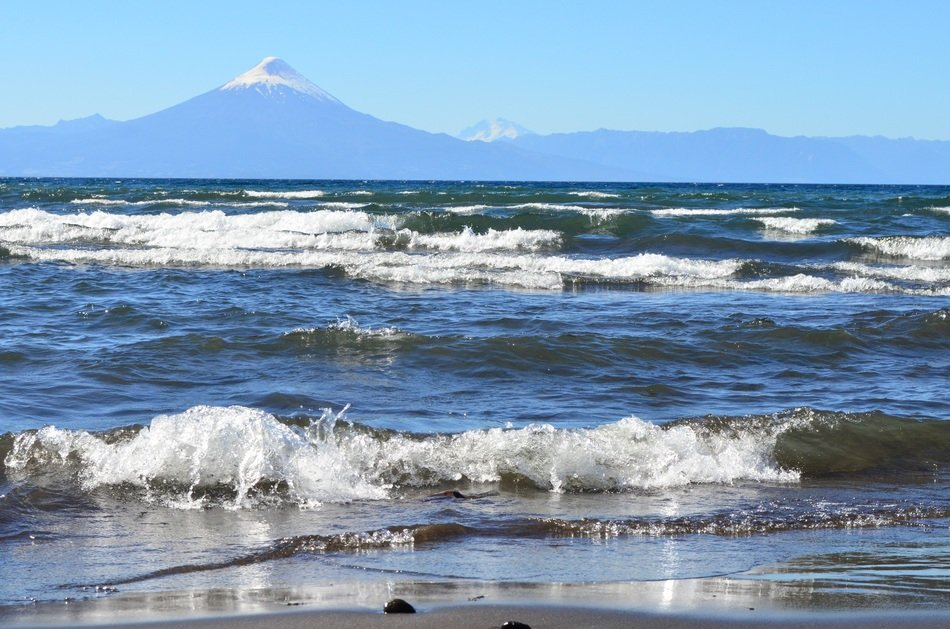 Osorno volcano at wavy lake, chile