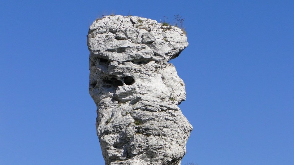 oblong rock against the blue sky