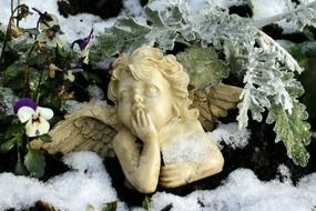 sculpture of a angel in the winter garden