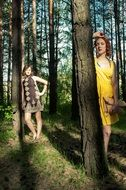 two girls in a sunny forest