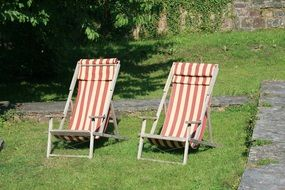 two sun loungers in the garden in summer