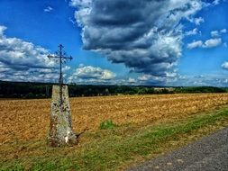 road cross with cloudy sky in france