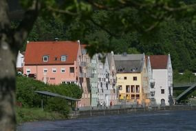 colorful houses at river, germany, riedenburg, altmühltal nature park