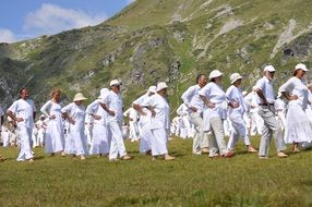 dancing people in white suits on the mountain in Bulgaria