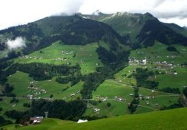 panorama of alpine mountain meadows in vorarlberg