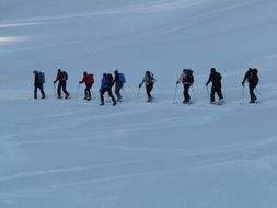 group of people in a hike on skis