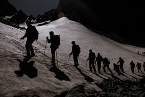 climbers go to the top of the mountain at night
