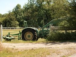 green tractor at farm