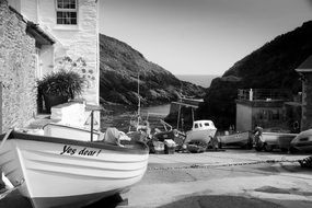 village on the coast in black and white image