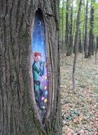 painting in a hollow tree