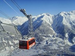 cable car over the snow-capped mountains
