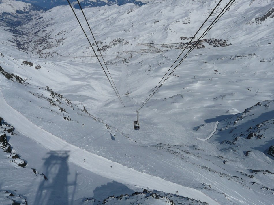 cable car among snow-capped mountains