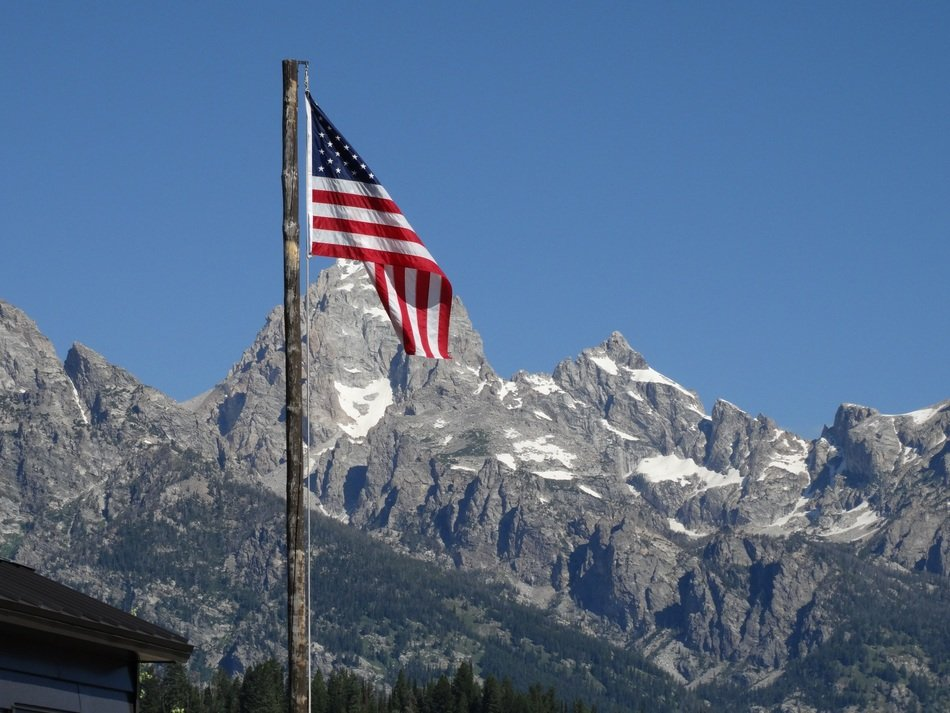 american flag in mountains