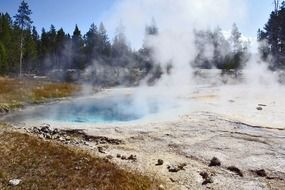 steam over the pond in Yellowstone National Park, Wyoming
