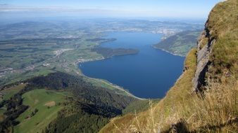view from the mountain to the blue lake in Switzerland