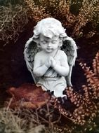 figurine of a praying angel kneeling