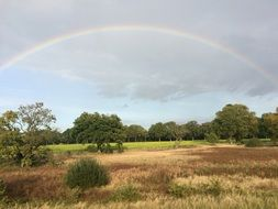 romantic rainbow over a rural field